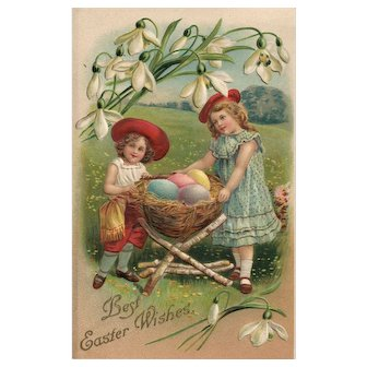 Children with a basket of eggs held by a birch wood stand Vintage Easter Postcard