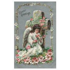 Easter Angel kneels in front of Cross with spring flowers vintage postcard