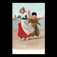 Adorable vintage Postcard featuring a Dutch boy and girl in wooden shoes Silk embellished