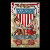 Patriotic Fourth Of July Boy and Girl Shooting Off Fireworks In front Of Shield Patriotic Postcard