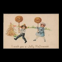 Simple & Fun I wish you a Jolly Halloween Children carry Pumpkin heads vintage postcard