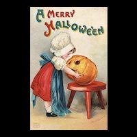 Signed Ellen Clapsaddle  Vintage Halloween Postcard Girl carves Pumpkin