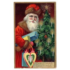 Red Robed Santa Claus by Tree with gifts vintage Christmas postcard