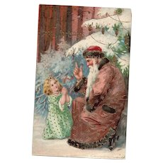 Precious Young girl Prays and pleads with a Brown Robed Santa Claus  Christmas Postcard