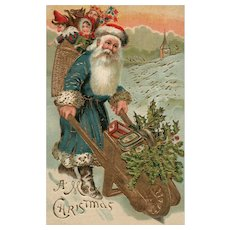 Gold Gilt Green Robed Santa Claus pushes wheelbarrow of goodies Christmas postcard