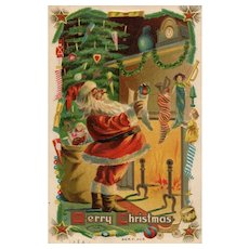 Vintage Merry Christmas Santa Hangs the stockings by the Fireplace Postcard