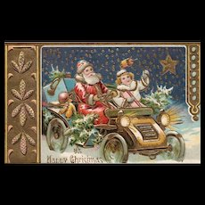 1907 Santa Claus driving in car with girl embossed Christmas postcard