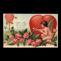 Cupid practicing with his Bow & Arrow Vintage Valentine with Roses Heart