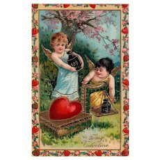 Gorgeous Gold Gilt Gel 1911 Vintage Valentine Postcard Cupids checking weight of heart 270