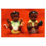 Black Memorabilia Sitting Boy and Girl Salt and Pepper Shakers