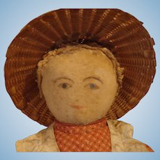 Primitive 19th Century Antique Cloth Rag Doll with a Watercolor Face and red calico dress.