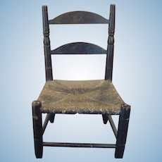 Black painted ladder back rush dolls chair in very nice condition