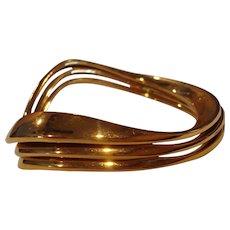 Set of 3 nesting goldtone Robert Morris Soho bangles for stunning accessory!