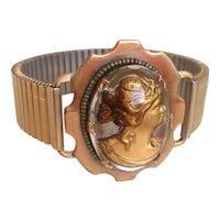 Engraved glass  gold-tone Aphrodite figurine on expanding watchband brooch bracelet, designer fashion jewelry