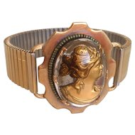 Engraved glass  gold-tone Aphrodite figurine on expanding watchband brooch bracelet, designer fashion jewelry