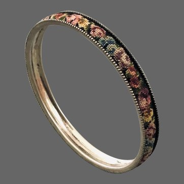 Dainty vintage silver bangle adorned with handmade flower embroidery flea market jewelry.