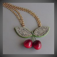 Lustful cherries and rhinestone crystals on romantic contemporary jewelry