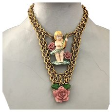 Vintage angel playing lute pendant and pink roses on gold plated metal chain long necklace romantic contemporary jewelry design