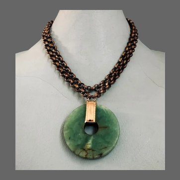 Green natural aventurine stone wheel pendant on brass chain necklace contemporary jewelry design upscale