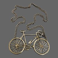 Vintage bronze bicycles pendant on long metal chain necklace one-off jewelry estate jewelry find