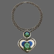 Big silvery heart pendant old metallic crystal rhinestones turquoise blue rose flowers on long brass chain necklace romantic contemporary jewelry design upscale