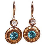 Gold plated disc earrings Swarovski turquoise crystals.