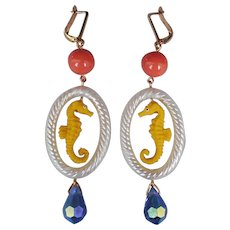 Whimsical rubber earrings yellow seahorse pendant blue Swarovski crystal drop earrings gold-filled lever back clasp high-end fashion jewelry design.