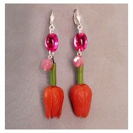Pink vintage plastic flower on contemporary earrings