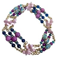 Very long bead necklace of blue cloisonné Czech fire polished and Swarovski crystal beads, pink purple stone beads and rhinestone roundels on gold-plated chain necklace statement jewelry design