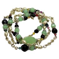 Very long necklace of vintage green glass gemstone black and green beads Swarovski crystals faux pearls and rhinestone roundels gold-plated chain necklace statement jewelry design