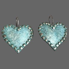 Vintage metal heart earrings oxidized turquoise coat with silver nails riveted around a handmade flea market aqua sky jewelry