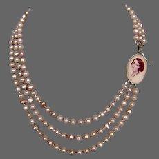 Feminine portrait cameo silver pendant pearl necklace upscale jewelry