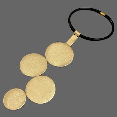 Gold tone leather circle pendant on black silicon choker bold elegant necklace chick couture jewelry design upscale