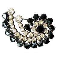Vintage snail shape pin brooch black and clear crystals costume bass clef jewelry design.