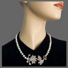 Designer pearl necklace and sterling silver flower pendant in vogue fashion jewelry design