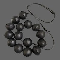 Chunky robust black leather beads on leather cord necklace vintage costume jewelry