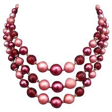 Three strands vintage red fuchsia burgundy plastic pearl necklace estate European jewelry