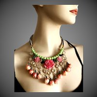 Flowers bib necklace vintage pink plastic roses green Czech fire polished and bezel set clear Lucite beads black & white handmade leather choker upscale jewelry design