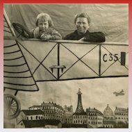 Real Photo Postcard of Faux Scene: Girl and Mother in Plane Flying Over Paris