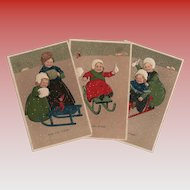 3 Antique Embossed Marie Flatscher Postcards of Children in Winter Sled Scenes