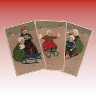 3 Antique Embossed Marie Flatscher Postcards of Children in Winter Sled Scenes