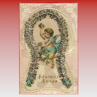 LAST CHANCE: Victorian Die-Cut of Angel Cherub Surrounded by Silver Christmas Garland 1909 European Novelty Postcard