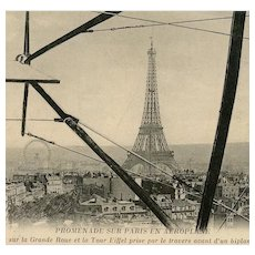 Aerial View of Eiffel Tower  and Paris Framed by Biplane Wing