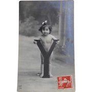 Antique French Real Photo Postcard Enfant Girl Standing in Front of Huge Letter Y