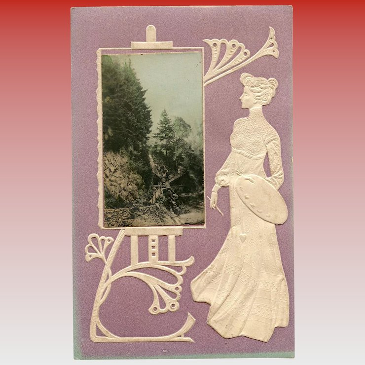 art nouveau embossed postcard of artist with palette looking at