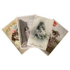 Blossoms Bows and a Book: 4 Antique French Postcards featuring Hand-Painted Real Photos of Young Girls