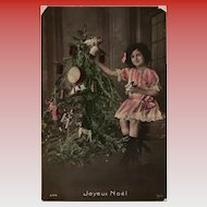 Joyeux Noel Edwardian Girl in Pink next to Tree Loaded with Toys Antique French Christmas Postcard