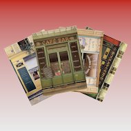 Four Paris Storefronts by French Painter André Renoux Unused Vintage Postcards