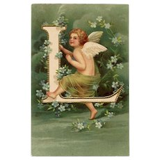 """Unsigned Clapsaddle """"L"""" Postcard with Angel Franked 1905"""