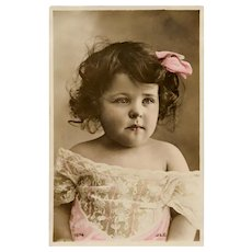 Ribbon-haired Toddler in Lace Antique Real Photo Postcard Colored by Hand